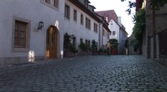 Stock Video Footage of Cobblestone Street in Rotenberg With Bicycle