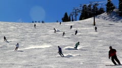 SKIERS BOARDERS DOWN A SLOP Stock Footage