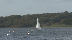 Dinghy being sailed on Rutland Water. - stock footage
