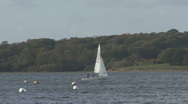 Stock Video Footage of Dinghy being sailed on Rutland Water.