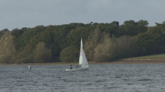 Dingy being sailed across Rutland Water. Stock Footage