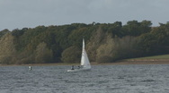 Stock Video Footage of Dingy being sailed across Rutland Water.