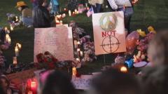 Day 3 - UMC AZ Vigil for victims symbolic signage peace not crosshairs Stock Footage