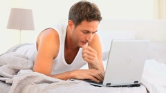 Annoyed man working on his laptop - stock footage