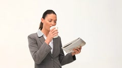 Businesswoman reading a newspaper Stock Footage