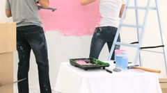 Nice couple painting the wall together Stock Footage