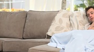 Woman bringing a glass of water to her sick husband Stock Footage