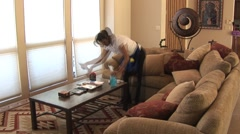 Cleaning woman in beautiful home living room- time lapse - stock footage