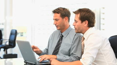 Coworkers working together on a laptop Stock Footage