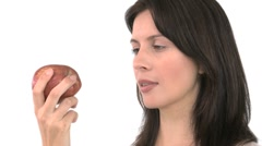 Smiling woman eating an apple Stock Footage