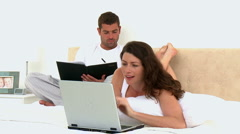 Couple looking at a video on the computer Stock Footage