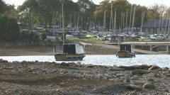 Boats moored to buoys on Rutland Water move on wind. - stock footage