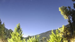 Time lapse of startrails and full moon setting over Pine Mountain Club Stock Footage