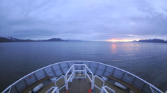 Point of view time lapse of a ship cruising up Chatham Strait at dusk - stock footage