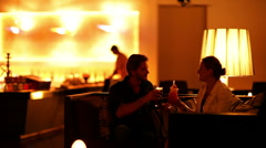Couple enjoys cocktails at bar Stock Footage