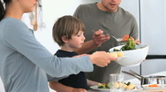 Stock Video Footage of Man serving a salad to his family for lunch
