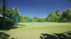 Tropical tennis court Stock Footage