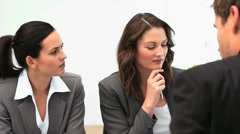Businessteam working in a meeting - stock footage