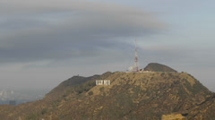 Time lapse motion of clouds blowing over the Hollywood sign and Cahuenga Peak Stock Footage