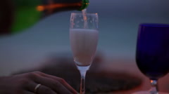 Pouring champagne into glass Stock Footage