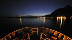 Point of view time lapse of a ship leaving Sitka at night and cruising up Olga Stock Footage