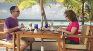 Couple enjoying lunch at poolside Stock Footage
