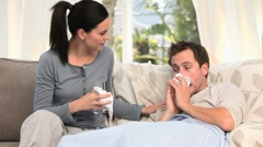 Stock Video Footage of A woman cares for her sick husband