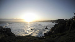 Time lapse of waves and sunrise over Pacific Grove Marine Garden Park in Pacific Stock Footage