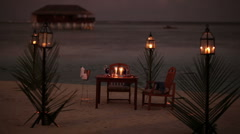 Lonely dining table on a beach Stock Footage