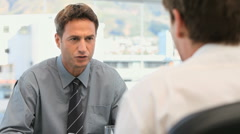 Manager talking with an employee Stock Footage