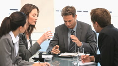Businesspeople having a discussion during a meeting - stock footage
