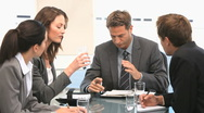 Businesspeople having a discussion during a meeting Stock Footage