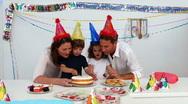 Boy cutting his birthday cake Stock Footage