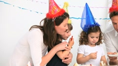 Family having fun during a birthday party Stock Footage