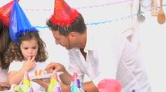 Family enjoying a birthday party - stock footage