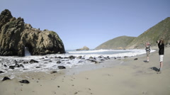Time lapse of waves breaking on a beach and through a rock at Pfeiffer Beach Stock Footage