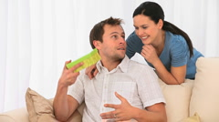 Woman offering a gift to her husband Stock Footage