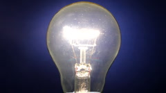 Light bulb flickering on and off Stock Footage