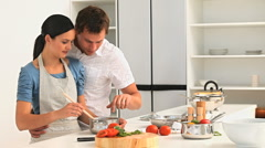 Couple preparing the dinner Stock Footage