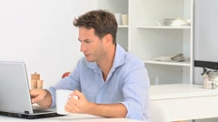 Happy man chatting on the laptop Stock Footage