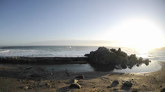 Time lapse of waves breaking over a sea wall at Pacific Grove Marine Garden Park Stock Footage