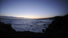 Time lapse of waves before sunrise over Pacific Grove Marine Garden Park Stock Footage