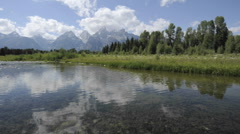 Time lapse of clouds at Schwabacher Landing in Grand Teton National Park Stock Footage