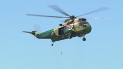 Sheriffs Rescue Heli fly in pick up guy Stock Footage