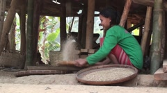 Thai woman sifting rice - stock footage