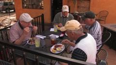 Men Eating Stock Footage