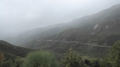 Time lapse of fast rainstorm clearing over the Santa Ynez Mountains above Ojai Stock Footage