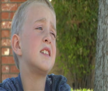 Cute blonde little boy begs for more time Stock Footage