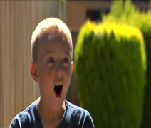 Cute little boys jaw drops in shock Stock Footage