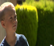 Head turn and portrait of cute little blonde boy Stock Footage